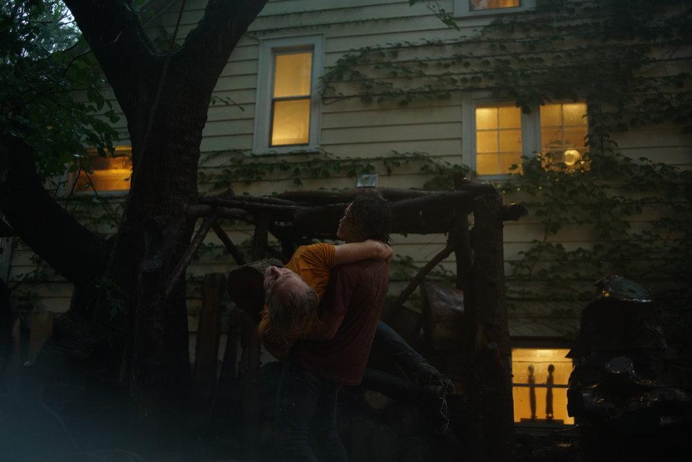 Performance documentation photograph by Bryan's son, Jake Saner, amidst thunder and rain. 2017.