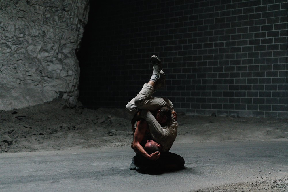 Performance documentation from when  Carriage  was performed in a limestone cave network in Kansas City as part of Open Spaces, curated by Dan Cameron. The work moved deeper into the cave over time, inviting the audience to follow on foot and change their physical relationship to the work. 2018.