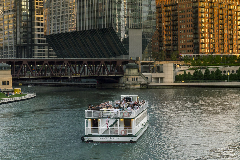 Performance documentation from when  Carriage  was situated site-specifically aboard a moving vessel on the Chicago River. The performance took on the title  A Vessel For Carriage  and was tuned to the boat, the moving water, and the trajectory of the river artery. Co-produced with Peter Taub. 2018.