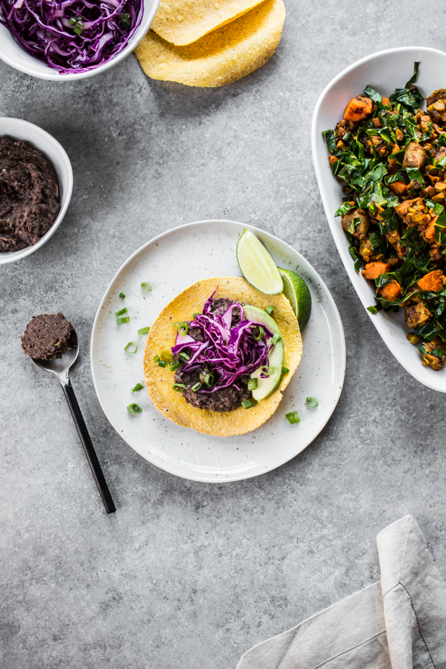 Breakfast Tostadas with Refried Black Beans and Cabbage Slaw (recipe by Gena Hamshaw in Food52 Vegan) | edibleperspective.com
