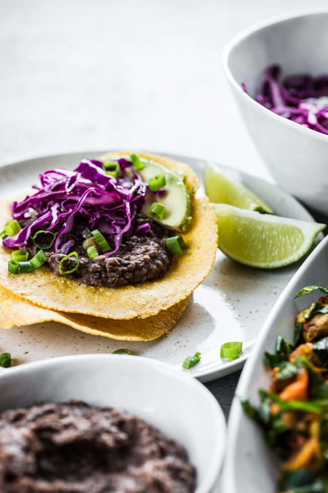 Vegan Breakfast Tostadas with Refried Black Beans and Cabbage Slaw | edibleperspective.com