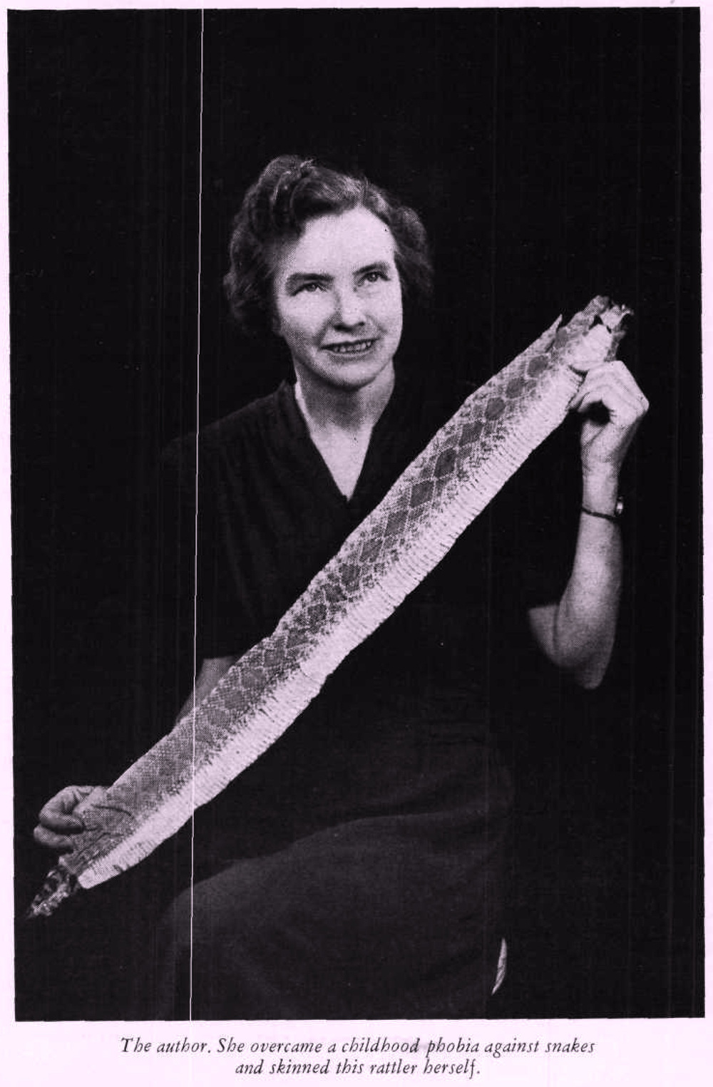 Melissa Branson Stedman with the snake she skinned.