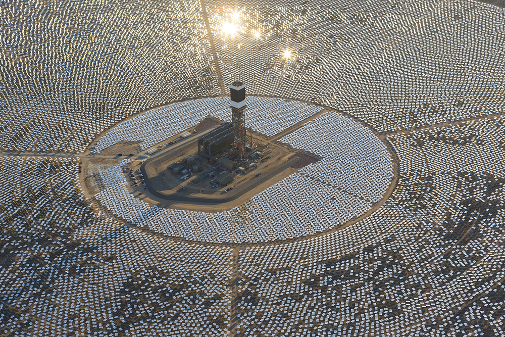 The Ivanpah Solar Power Facility in the Mojave Desert. Conceived in 2008 and backed by the state of California and Google, among others, Ivanpah is the world's largest concentrated solar-thermal power plant. This type of plant uses giant mirrors to concentrate light that heats water to power turbines. Since 2008, the price of photovoltaics (solar panels) has fallen so dramatically that most renewable-energy authorities, including Google, no longer believe that solar-thermal plants are practical. According to a recent AP report, Ivanpah is currently producing at just 50 percent of its capacity.   Photo: BrightSource Energy