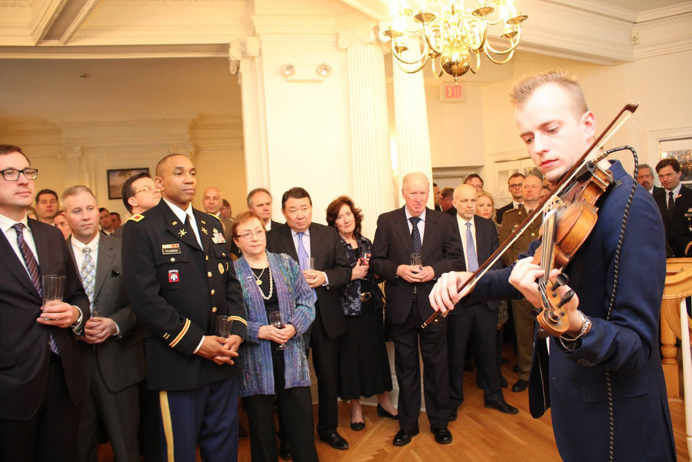 Valev Laube performing Estonian folk tunes and contemporary folk music to government officials at the Estonian Embassy