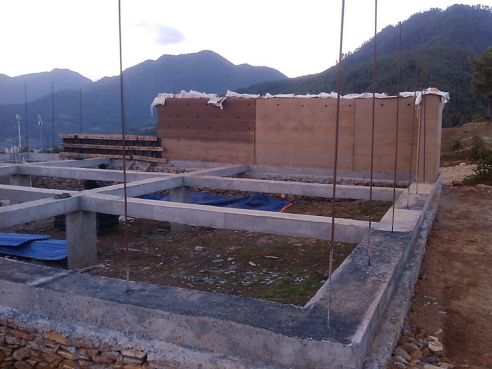 Completed foundations and rammed earth wall