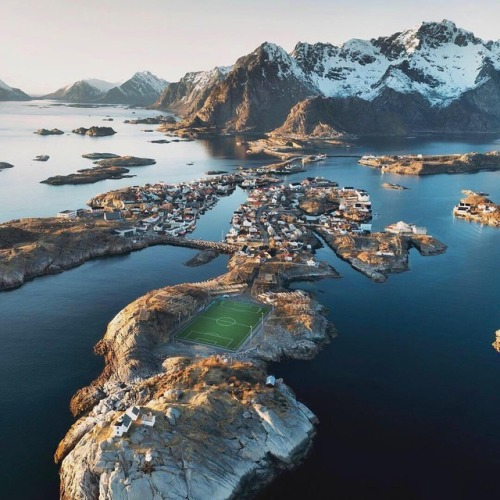 A football field in the Lofoten Islands in Norway.  How many balls do you think get lost to the sea?  Photo from  VisitNorway .
