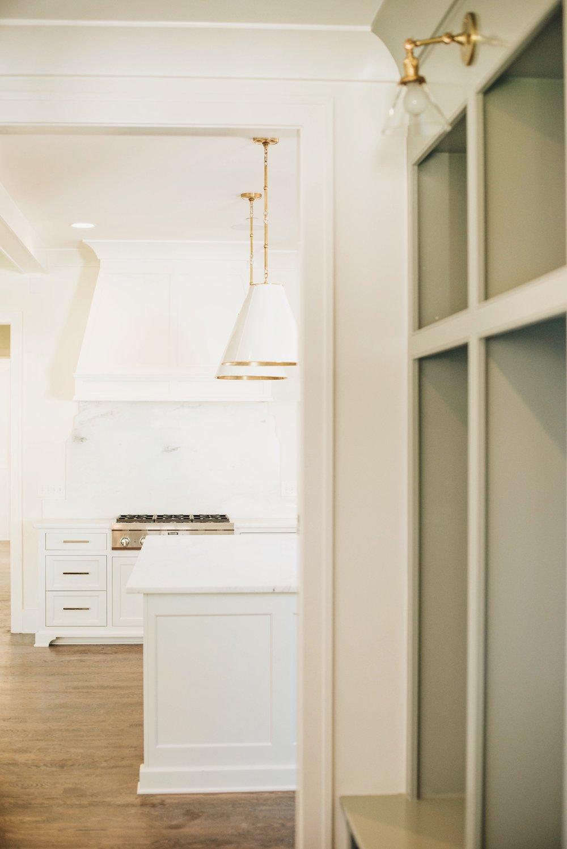 Mudroom Built Ins: BM River Gorge Gray | Kitchen Cabinetry: BM White Dove | Sarah Catherine Design