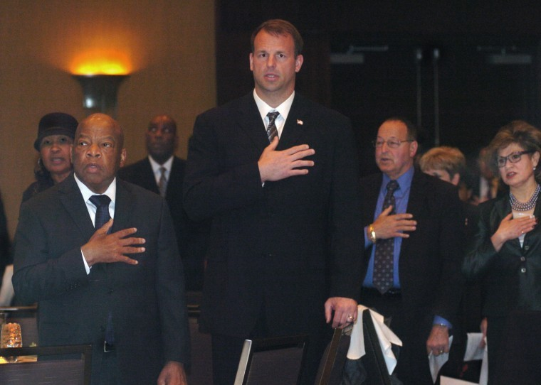 Congressman John Lewis, left, and Congressman Jon Runyan, center, stand during the playing of the National Anthem, at the National Stop the Violence Alliance's Celebration of Hope Gala, at the Westin Hotel in Mount Laurel. Lewis, a civil rights icon, was honored with a bust on Saturday night for all his years of battling oppression and inequality. Congressman Lewis was one of several being honored. Photo courtesy of: Pete Picknally/BCT Staff Photographer