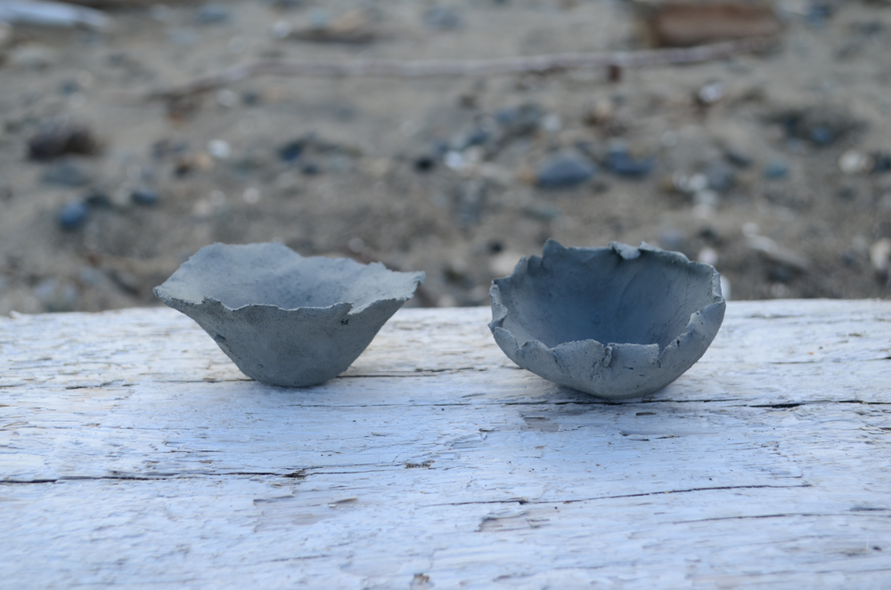 Found clay in a riverbed and made some tiny pots.