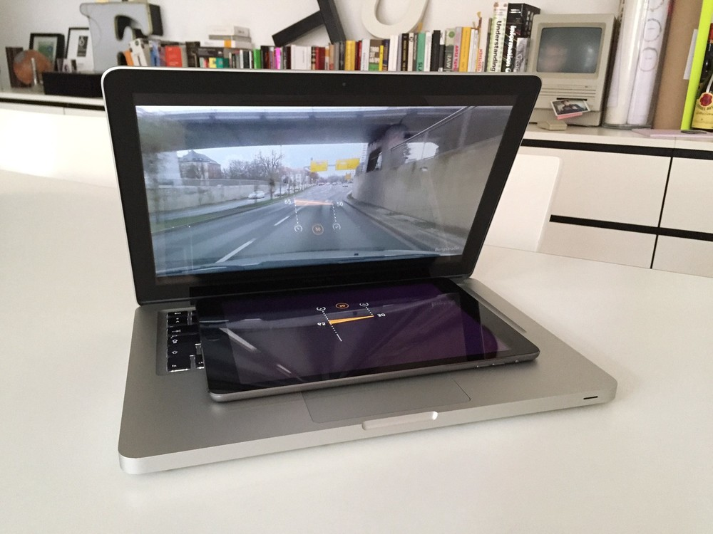 A great prototyping hack to test reflection in front of moving images: Placing an iPad with the mirrored HUD mockup under a tilted MacBook screen that is showing a driving video from YouTube. © Raureif GmbH