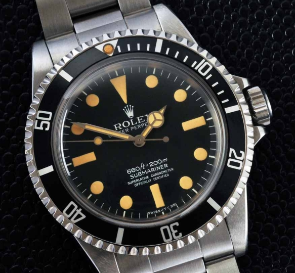 The indices on this Rolex we're once stark white, but have faded to a warm patina from being worn for 50+ years.