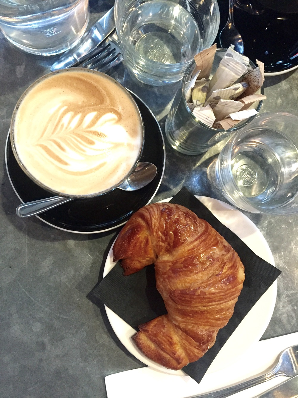 Cafe au lait and a butter croissant of flaky perfection.