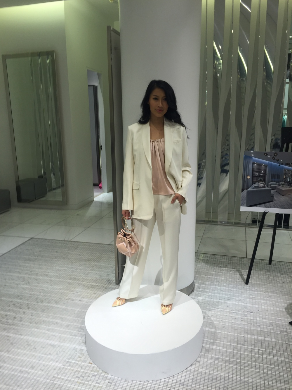 Suit and pink shell, HELMUT LANG. shoes, VALENTINO. bag, ROGER VIVIER.