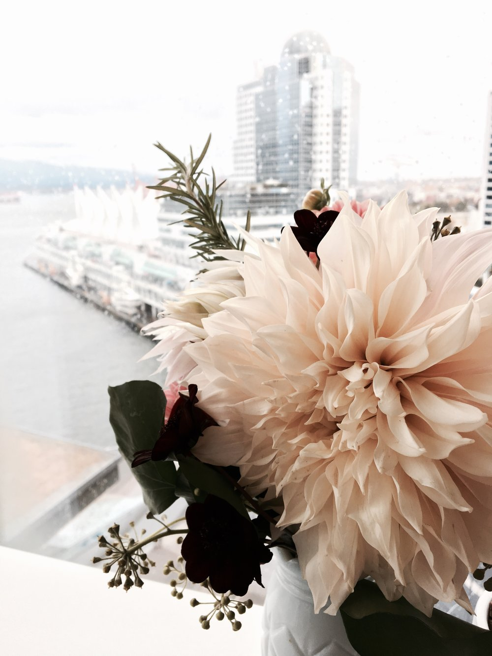 Gorgeous flowers from The Flower Factory overlook the stunning view of Canada Place and Burrard Inlet.