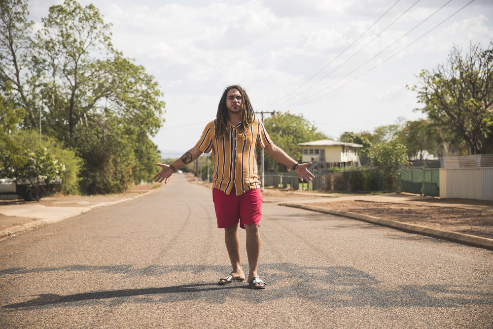 Dallas stands on the street he grew up in.