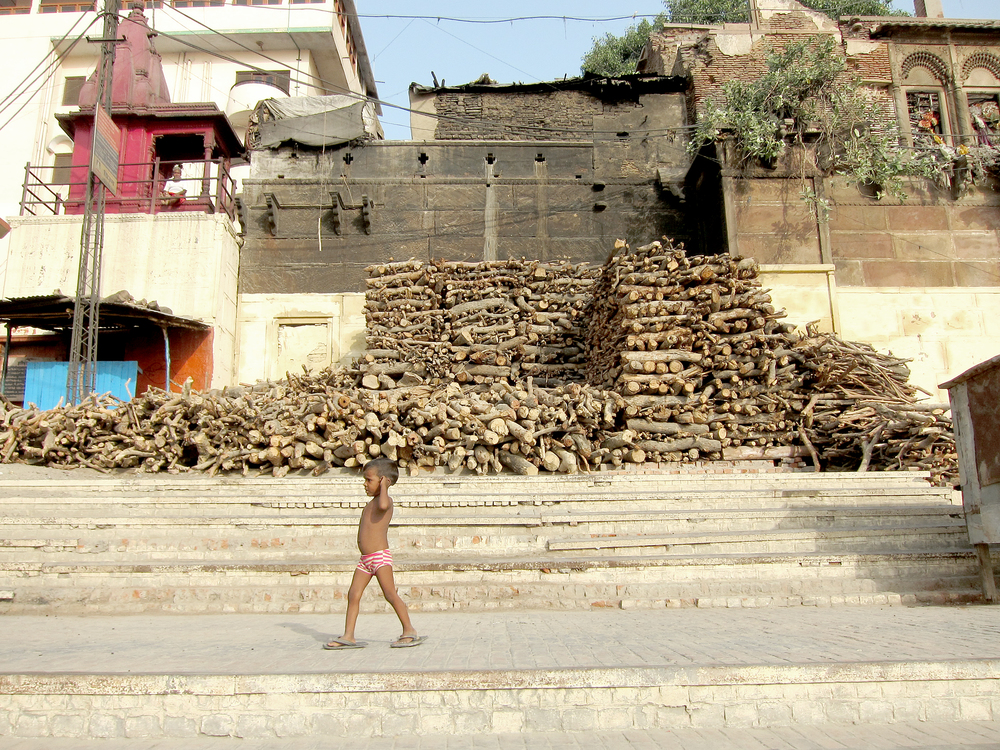 Boy & Pyre Wood - Varanasi, India