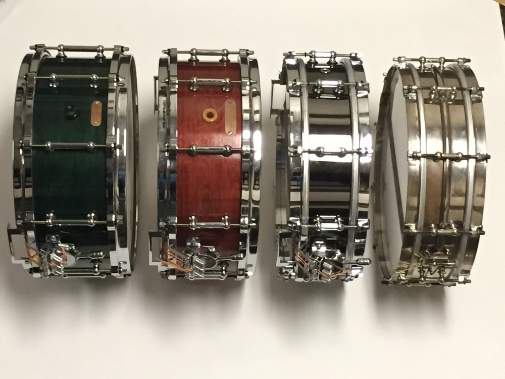Some of my concert snare drums left to right: 6.0x14 Eames, 5.5x14, Eames, 4x14 Brass Pearl Philharmonic, 4x14 Ludwig Nickel over Brass 1920s