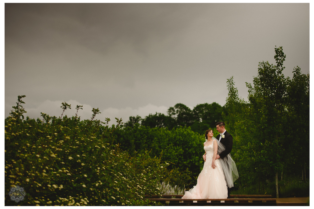 AriusPhoto-Penn-State-Wedding-Arboretum-Bride-Groom-Portrait-Cloudy-Sky-2.png