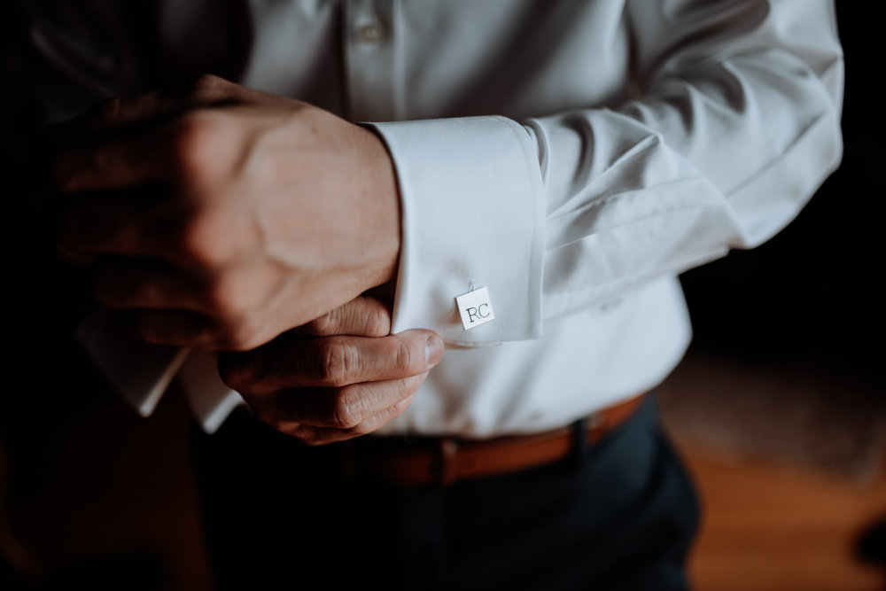groom fastens monogrammed  cufflinks
