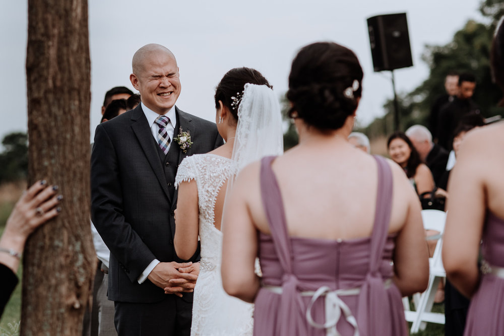 groom laughs during wedding cereomny