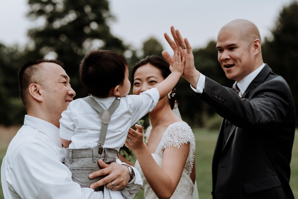 ring bearer gives high five to groom