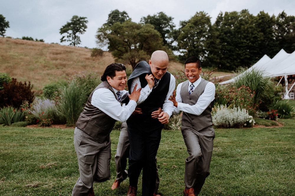 Red Maple Vineyard Wedding Pictures, groomsmen joke around