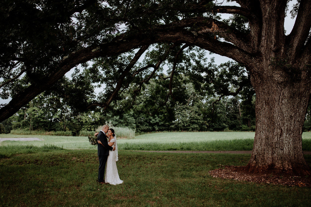 Elegant bride and groom portrait at red maple vineyard