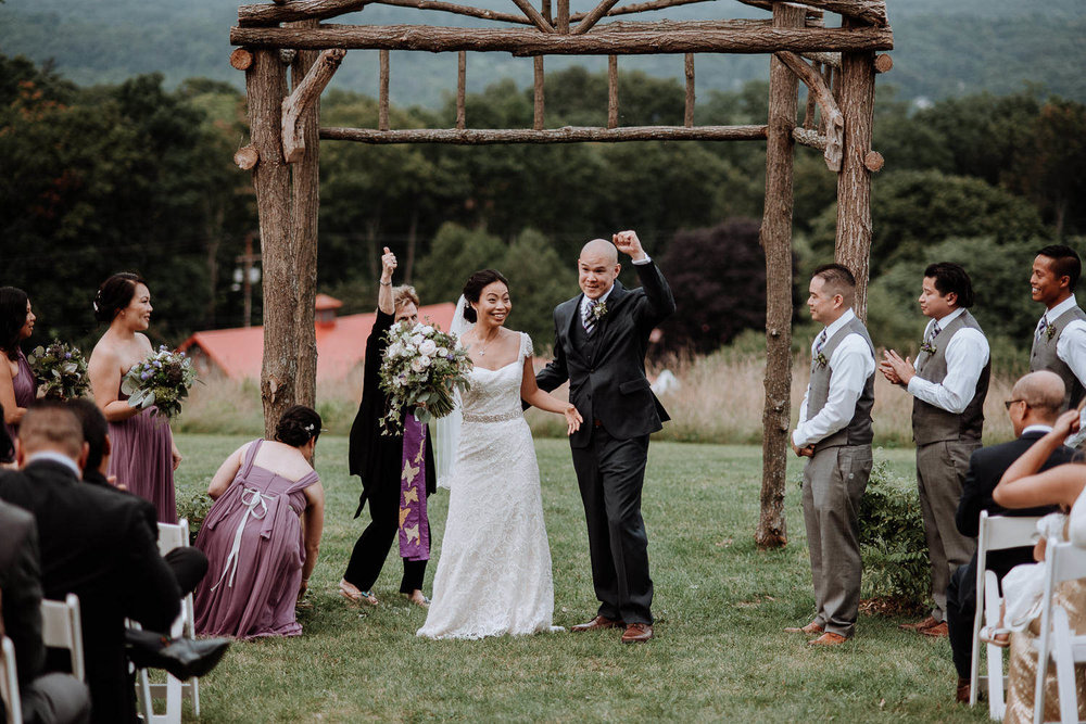 groom pumps fist in air after ceremony