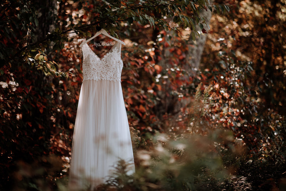 Catskill Wedding Photographer loves documenting weddings at Onteora Mountain House in Autumn. The red leaves are a perfect backdrop for this BHLDN lace and tulle dress.