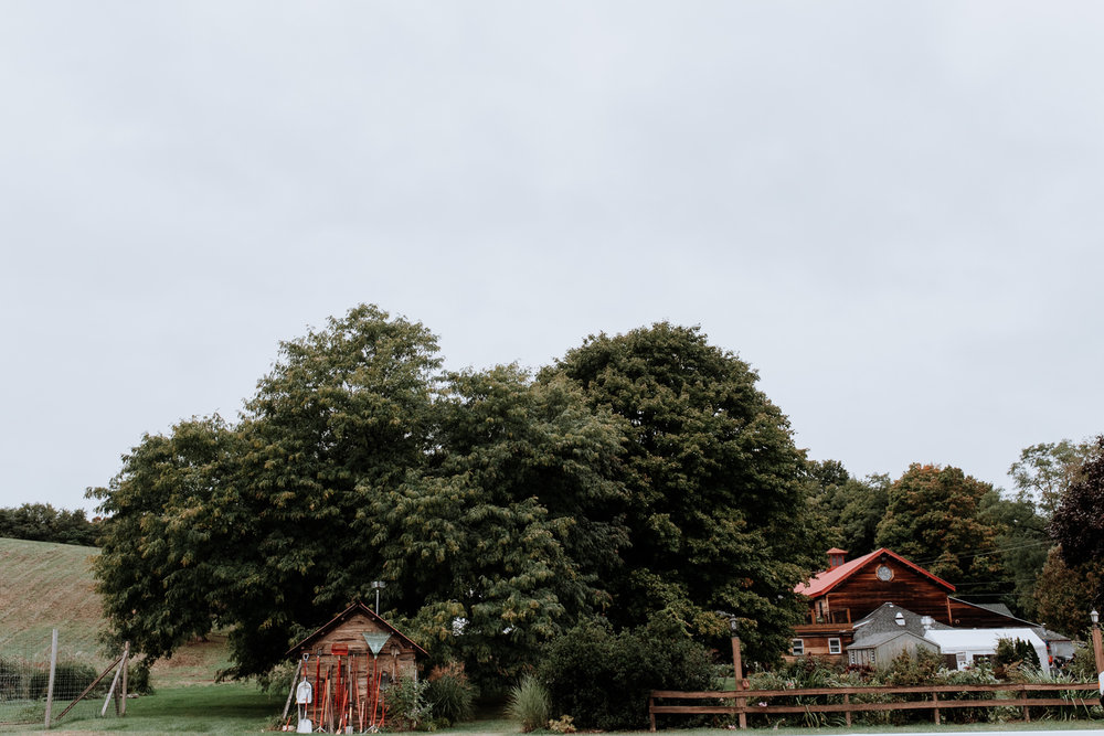 Cloudy day picture of red Maple Vineyard wedding venue in upstate New York