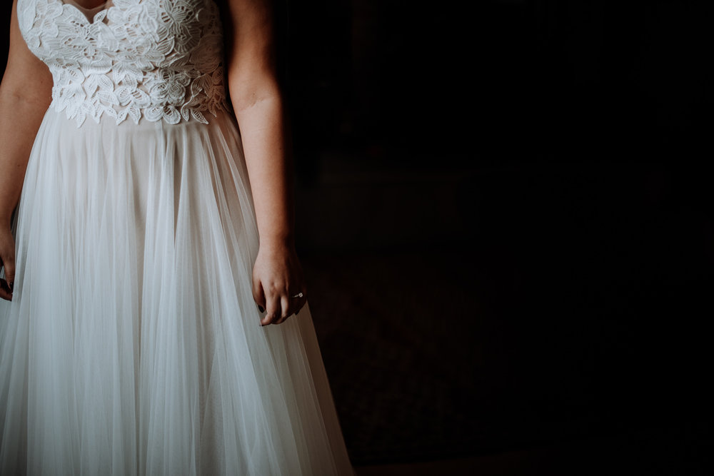 I love pausing during a busy moment and looking for the details. For where the story is happening. The way the window light hit the tulle on this BHLDN wedding dress was stunning.