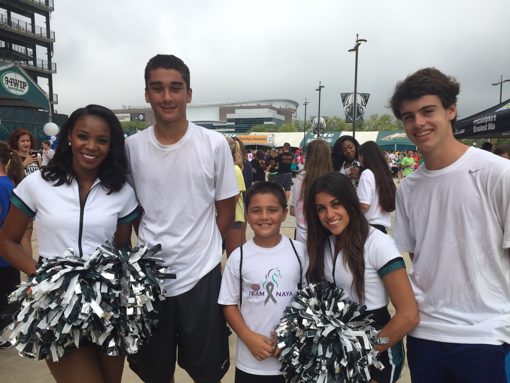 Boys with eagle cheerleaders.jpg