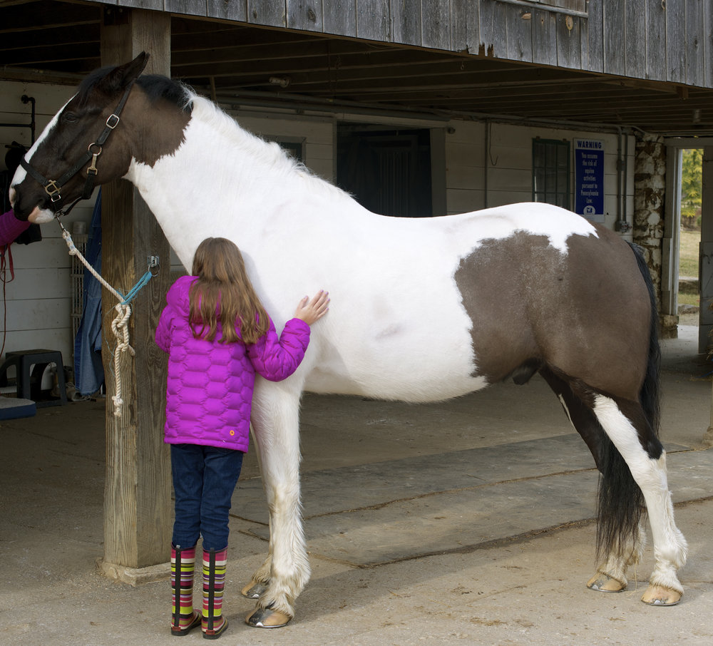 Naya with her horse, Jack,  weeks after her diagnosis and first brain surgery.