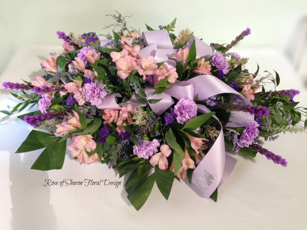 Lavender & Pink casket spray with tribute ribbon