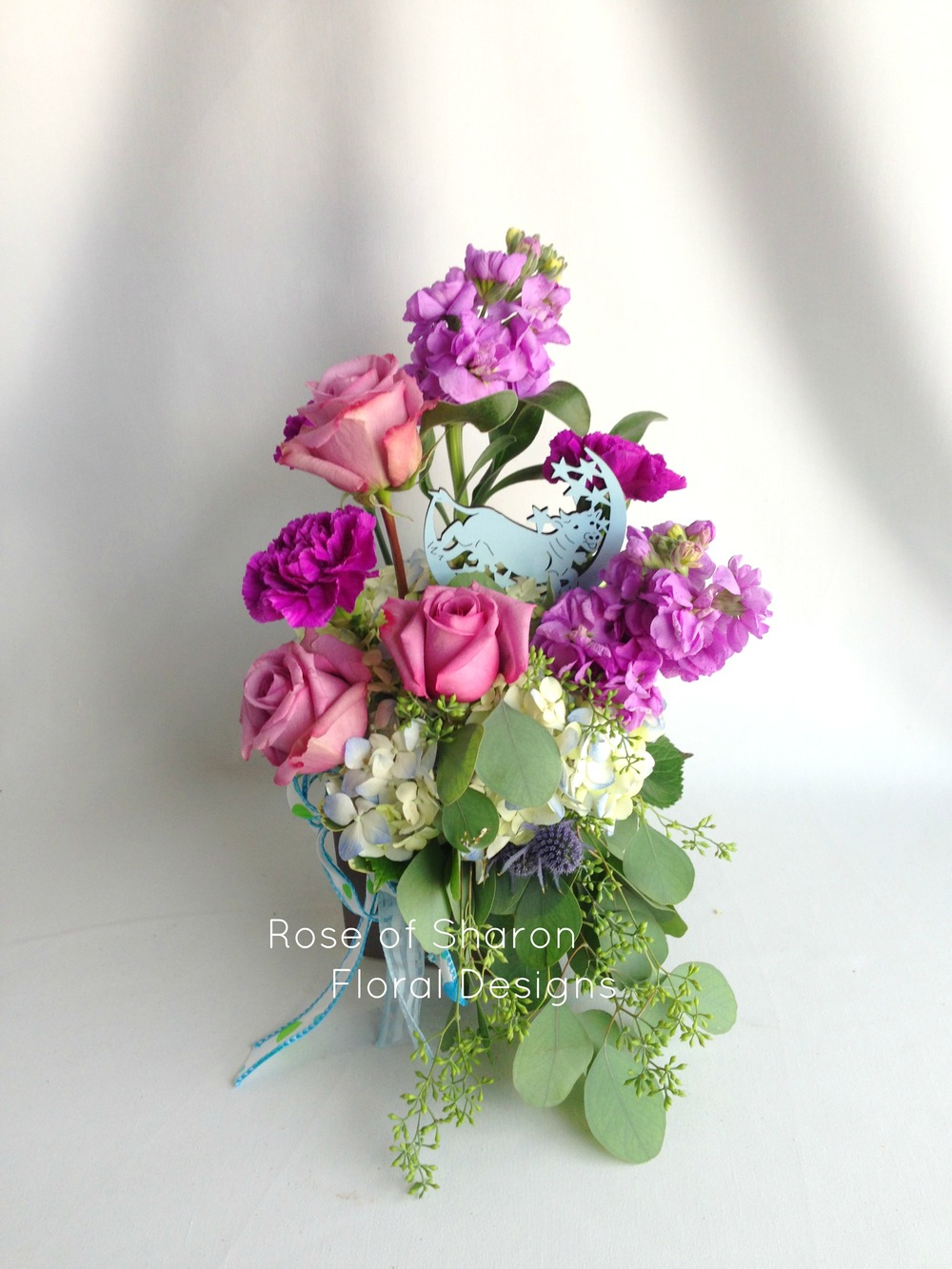 Purple and Blue Baby Arrangement featuring Roses, Thistle and Stock, Rose of Sharon Floral Designs