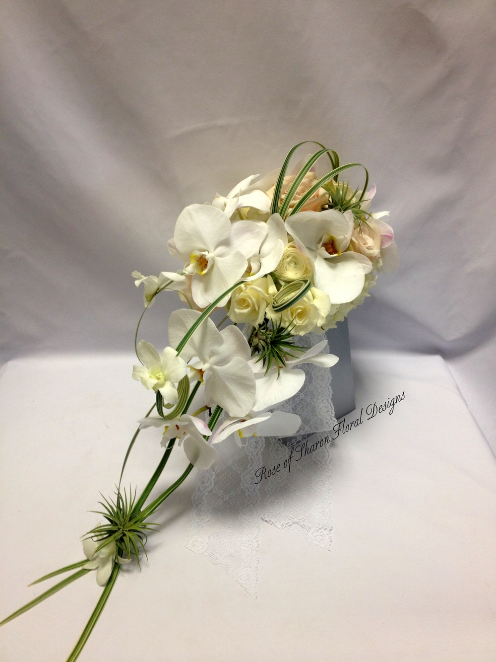 Cascading Orchid and Rose Bouquet. Rose of Sharon Floral Designs