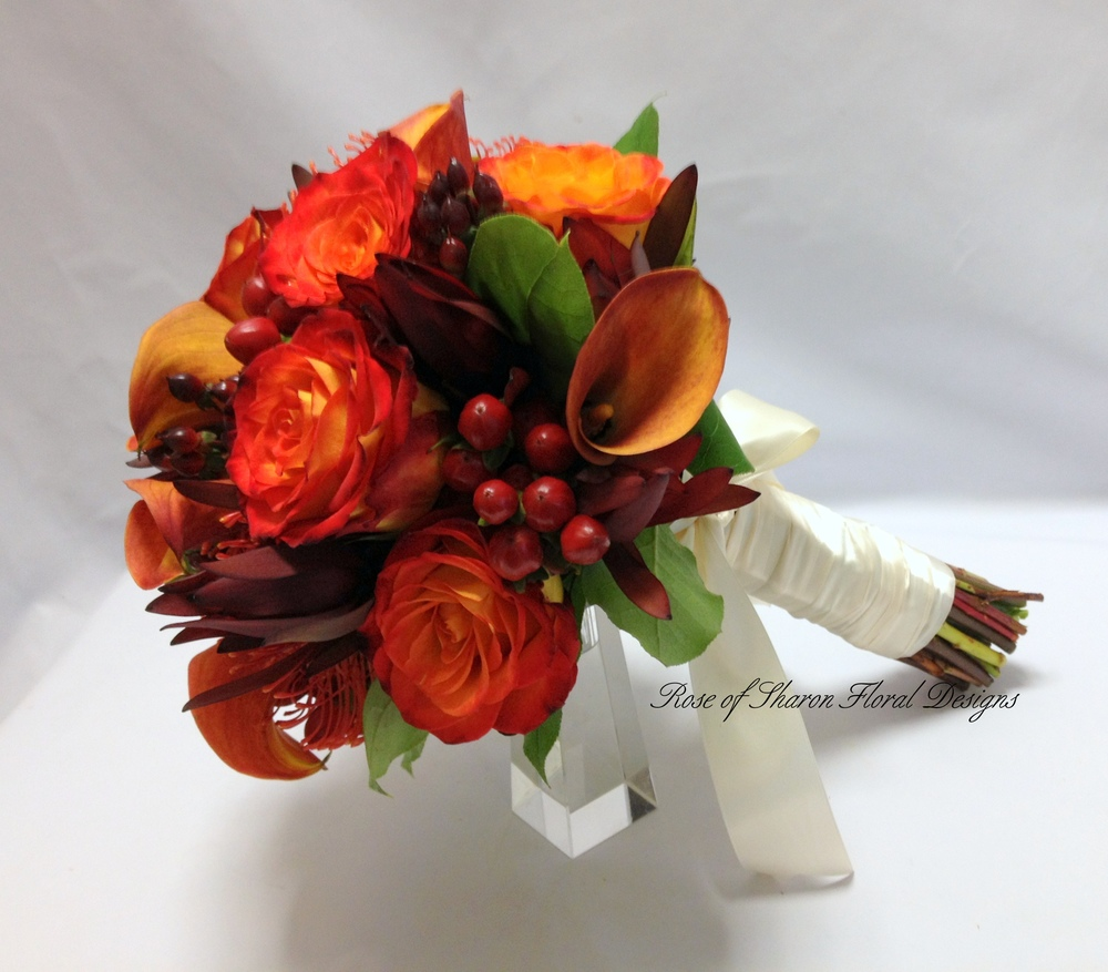 Orange and Burgundy Hand-Tied Bouquet with Calla Lilies, Roses & Hypericum Berries. Rose of Sharon Floral Designs