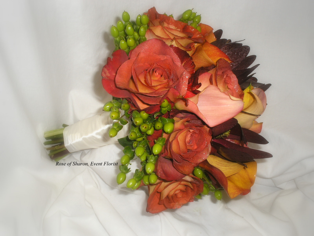Orange and Burgundy Hand-Tied Bouquet with Roses, Calla Lilies and Hypericum Berries. Rose of Sharon Floral Designs