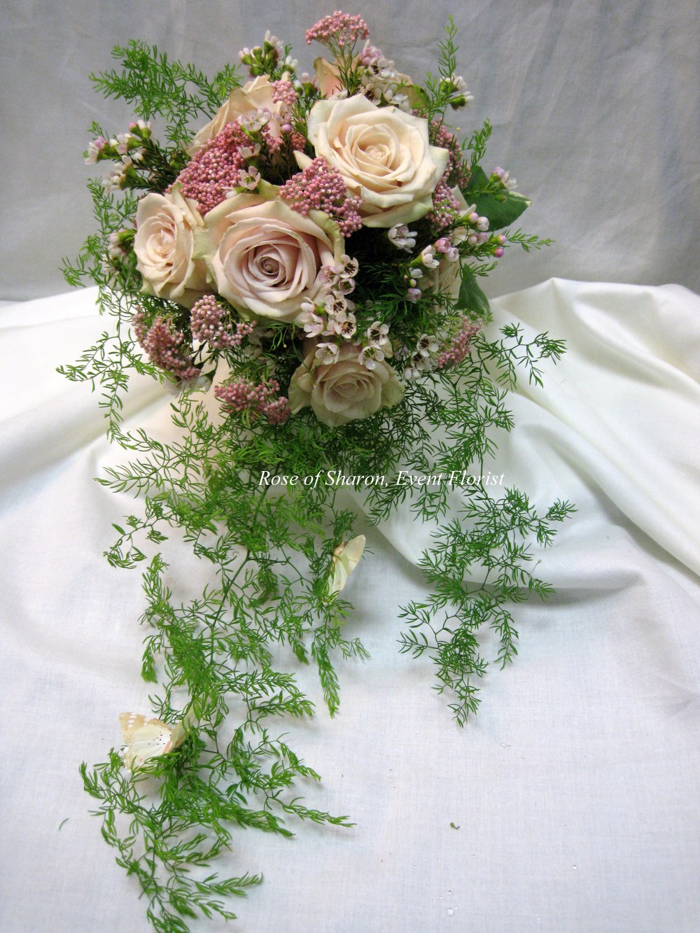 Natural Cascade Garden Bouquet. Pink and blush. Garden roses and waxflower. Rose of Sharon Floral Designs