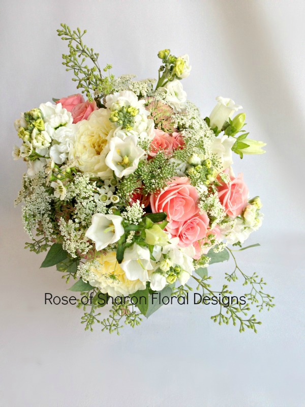 Mixed Garden Bouquet with Pink Roses, White Stock and waxflower. Rose of Sharon Floral Designs