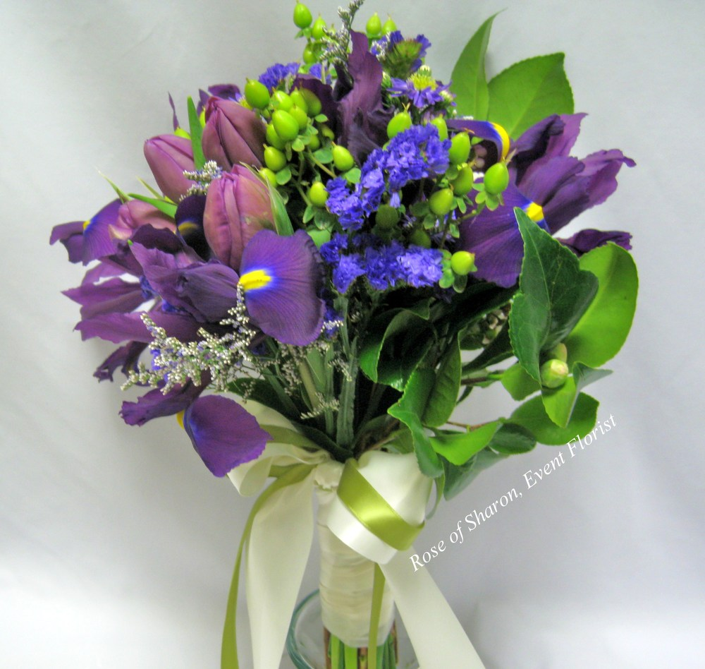 Purple and Green Hand Tied Bouquet with Purple Irises, Tulips, Statice and Hypericum Berries, Rose of Sharon Floral Designs