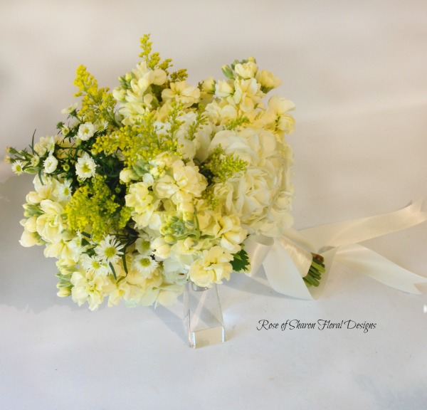 Soft yellow bouquet with hydrangeas, stock & solidago. Rose of Sharon Floral Designs