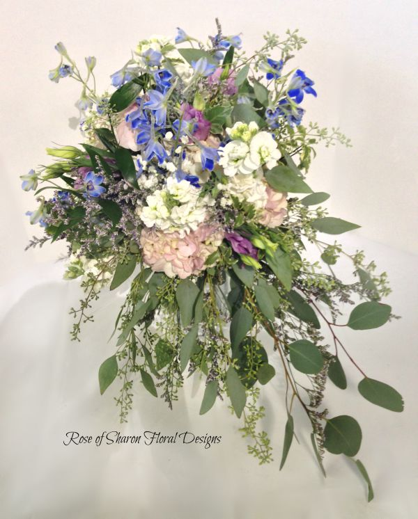 Blue and Pink Organic Cascading Bouquet with Hydrangea, Delphinium, Stock, and Assorted Greenery. Rose of Sharon Floral Designs.