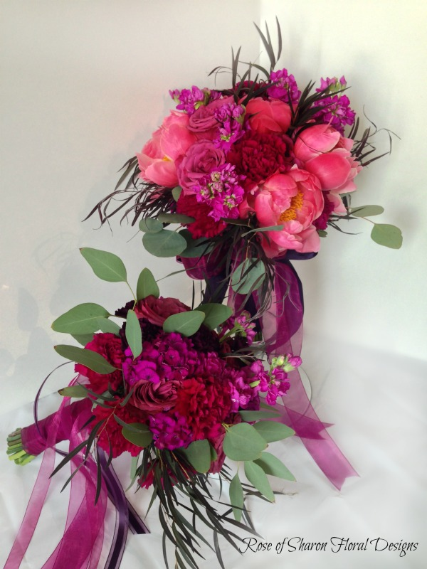 Hand-tied Garden Bouquet. Fuchsia and pink. Peonies, garden roses, stock and eucalyptus. Rose of Sharon Floral Designs.