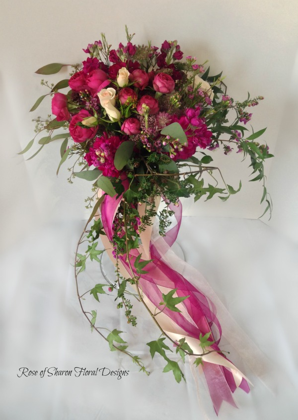 Natural Cascade Garden Bouquet. Fuchsia and blush. Spray garden roses, waxflower and stock. Rose of Sharon Floral Designs.