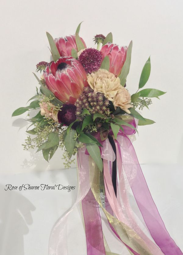 Garden bouquet. Pink and plum. Protea, eucalyptus. Rose of Sharon Floral Designs.