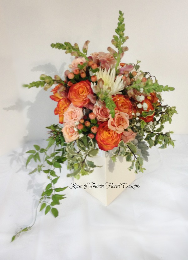 Orange and Peach Garden Style Bouquet with Free Spirit Roses, Hypericum Berries, and Snapdragons. Rose of Sharon Floral Designs
