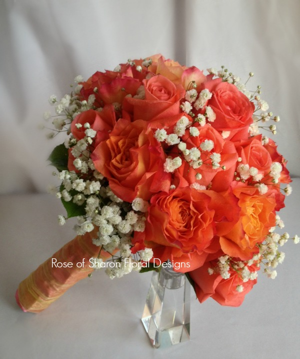 Orange Hand-Tied Bouquet with Free Spirit Roses and Baby's Breath. Rose of Sharon Floral Designs