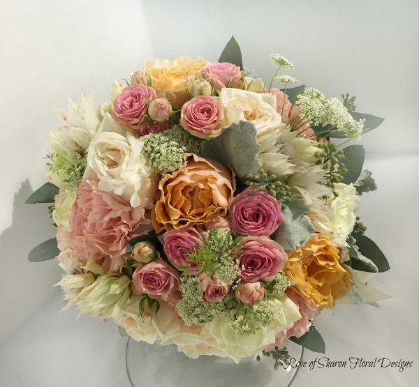 Peach Hand-Tied Bouquet featuring Roses, Queen Anne's Lace, and Blushing Bride Protea, Rose of Sharon Floral Designs