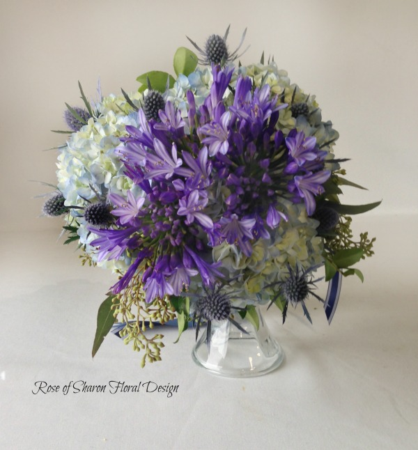 Blue Hand-Tied Bouquet with Hydrangeas, Agapanthus, and Thistle. Rose of Sharon Floral Designs.